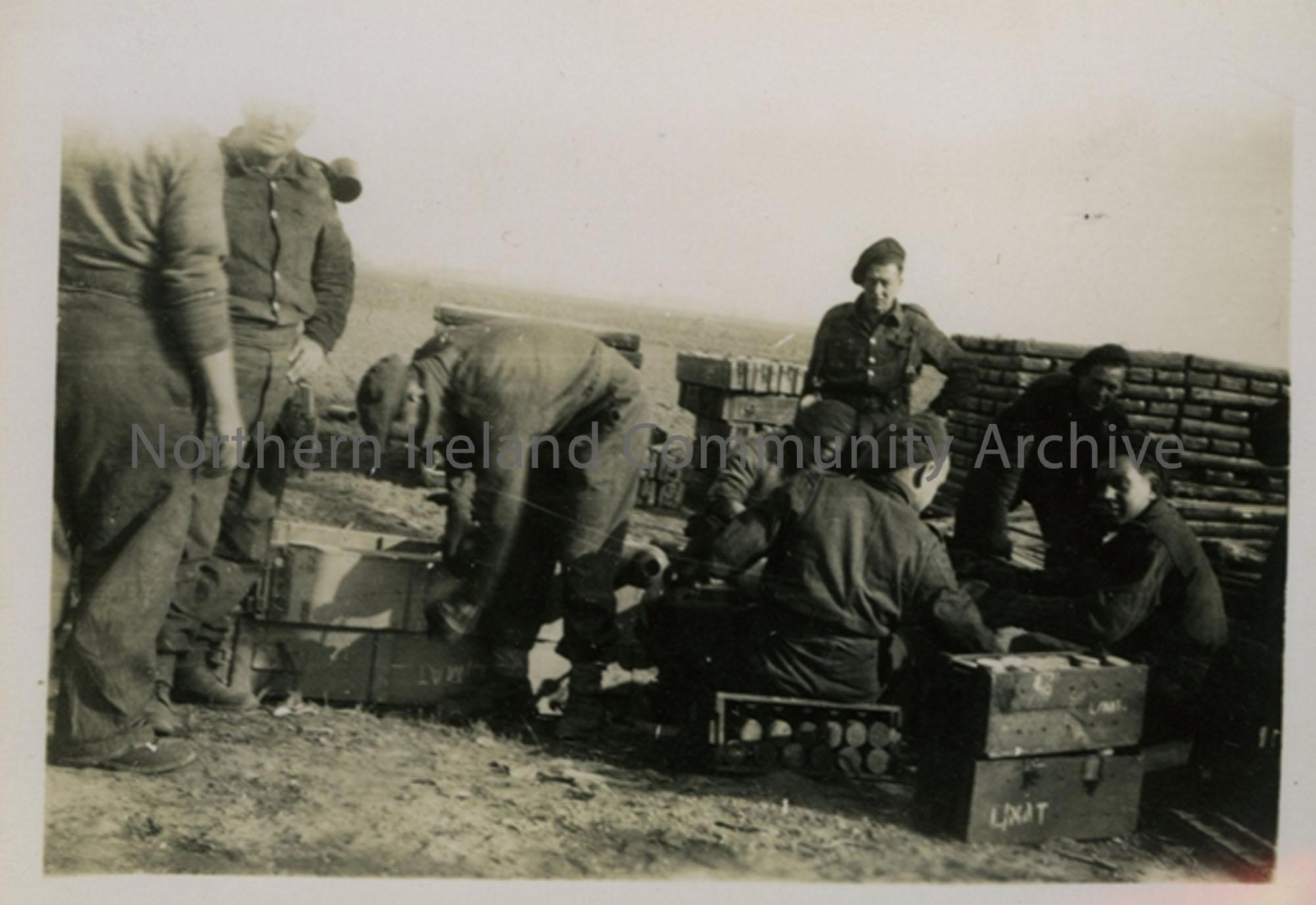 Group of soldiers with ammunition boxes
