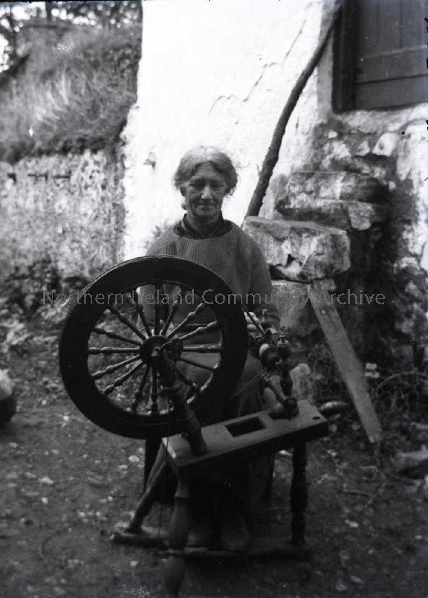 Lady working at spinning wheel