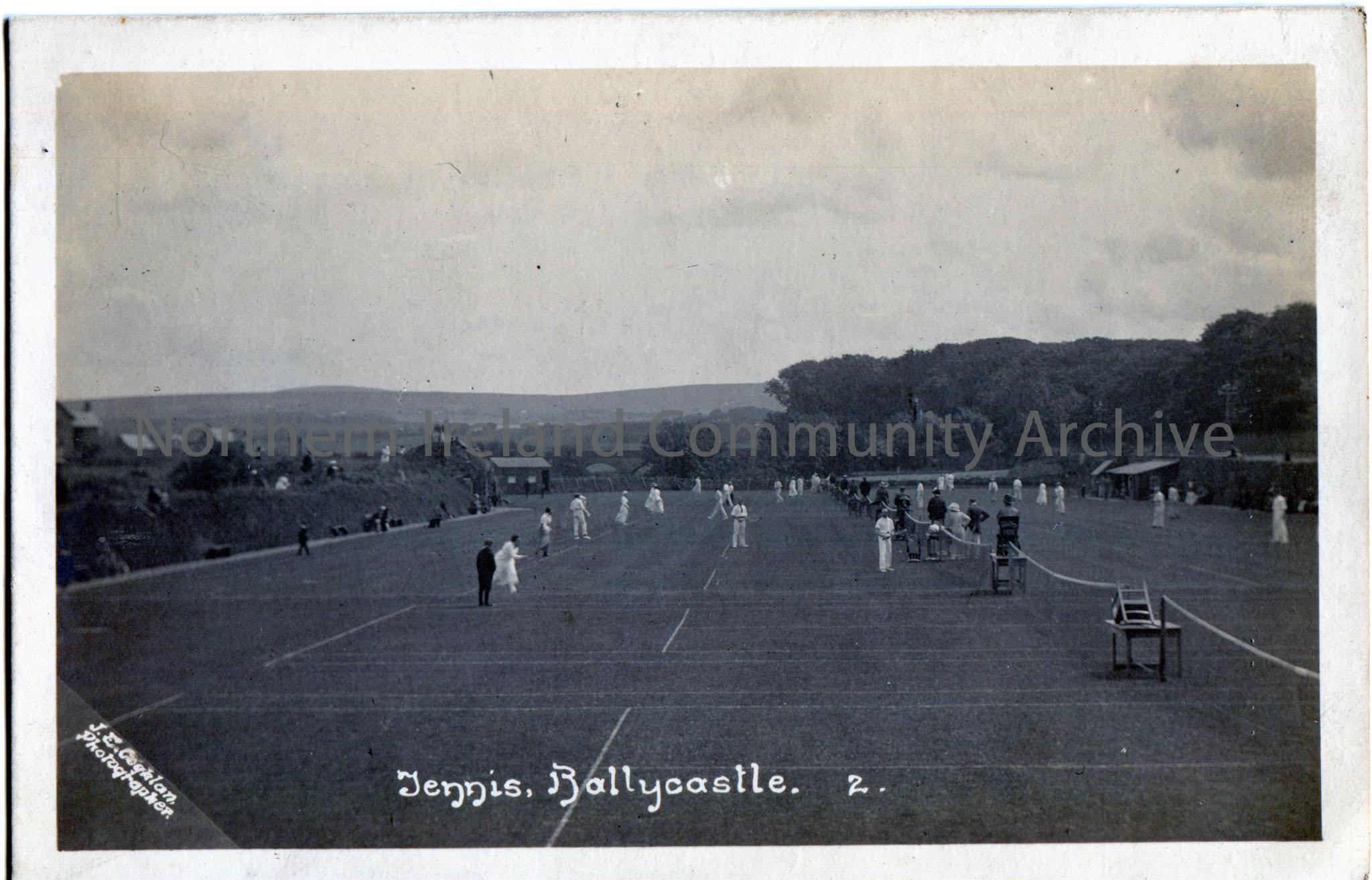 Black and white postcard showing a photograph of 'Tennis, Ballycastle'.