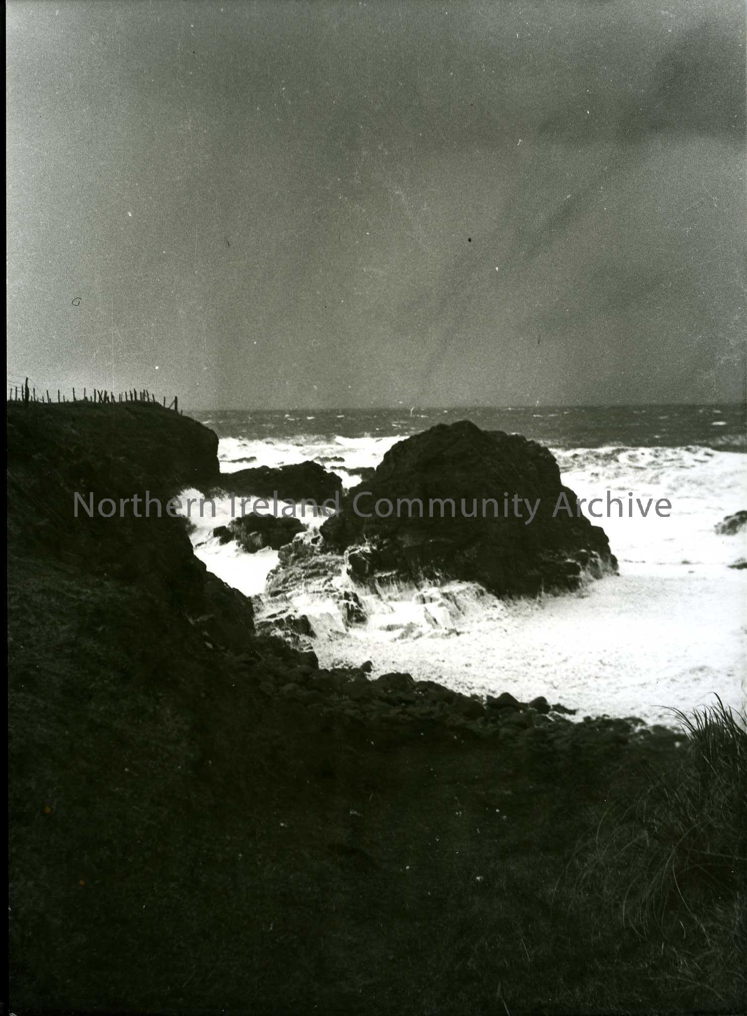 Printed black and white photograph – Sea, rocks and cliff edge.