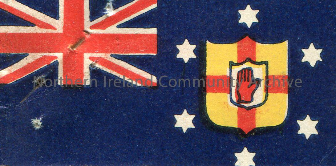 Small, paper flag of Northern Ireland. Union Jack is in the top corner. It also features the Coat of Arms which is surrounded by 6 stars. The same ima…