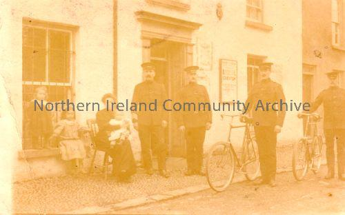 Dervock Police Station, with the sergeant and four officers of the Royal Irish Constabulary. The lady and the three children are the sergeant's family. At this time there was also a courthouse in Dervock. (2643)
