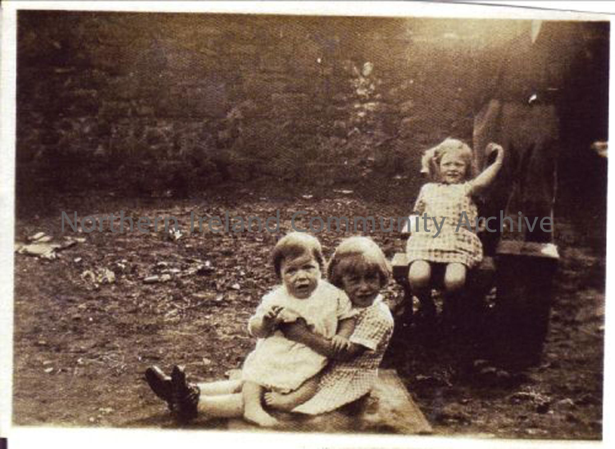 Annie and Jean White, with Molly Boyd in the garden at the White's house, which was a Nissan hut on the Taughey Road, Balnamore, c1930. (5372)