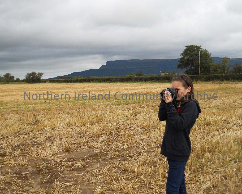 Rachel Cochrane the Great Great Granddaughter of Thomas Nicholl founder of the Broighter Gold, taking some creative photo's in the actual field where he discovered the gold.  A moment that captures a very unique golden link to the past!