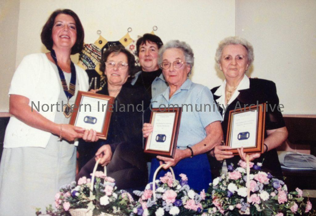 Members of Aghanloo Women's Institute being presented with their honorary membership plaques.